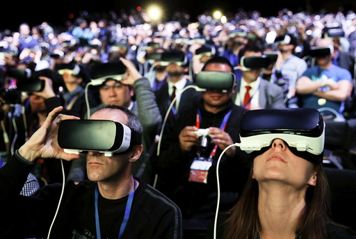 People wear Samsung Gear VR devices as they attend the launching ceremony of new Samsung S7 and S7 edge smartphones during the Mobile World Congress in Barcelona