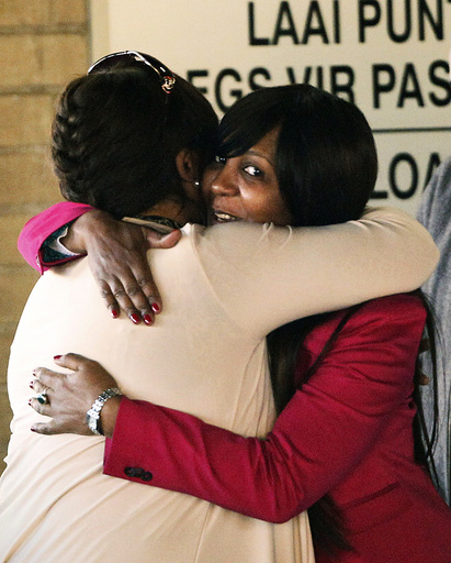 Zindzi Mandela, daughter of former South African President Nelson Mandela, hugs her niece at the hospital where he is being treated in Pretoria
