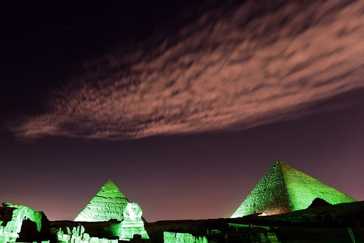 The Great Pyramids and Sphinx lit in green light