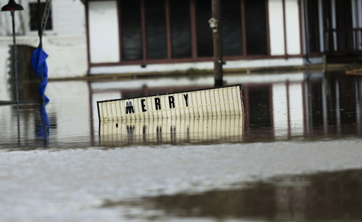 A sign sits underwater located in the downtown area of Elba
