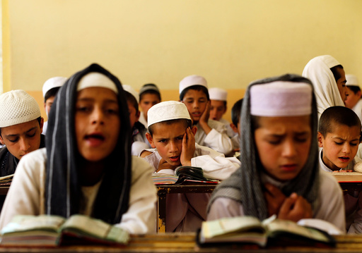Afghan boys read the Koran in a madrasa, or religious school, during the Muslim holy month of Ramadan in Kabul