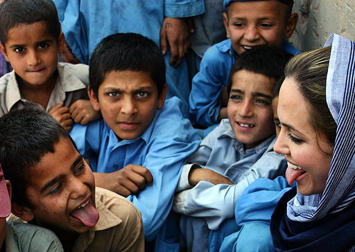 Hollywood actress and Oscar winner, Angelina Jolie, plays with Afghan refugee children during her ...