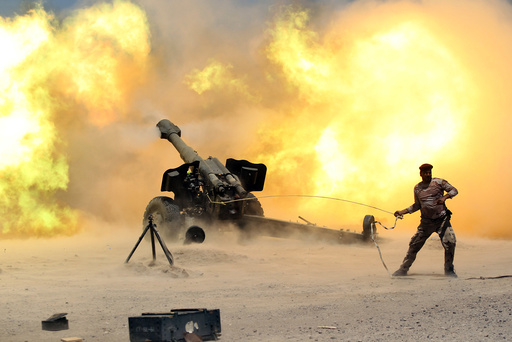 A member of the Iraqi security forces fires artillery during clashes with Islamic State militants near Falluja