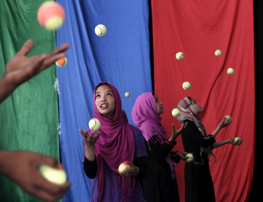 Girls, who are part of Afghan Mobile Mini Circus for Children (MMCC), participate in a juggling competition in Kabul