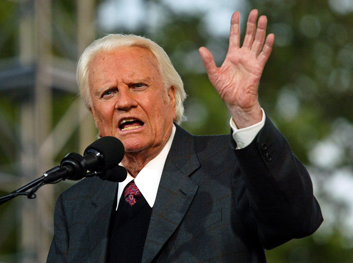 FILE PHOTO - Evangelist Billy Graham speaks during his Crusade at Flushing Meadows Park in New York