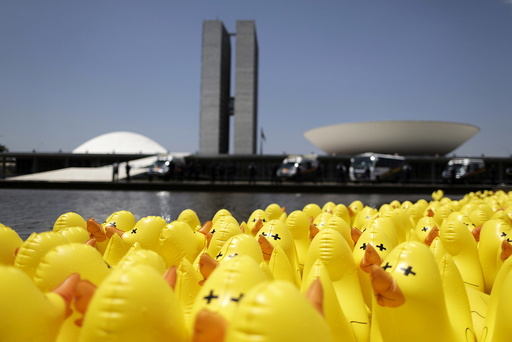 Inflatable dolls in the shape of ducks are seen in front of the National Congress during a protest against tax increases in Brasilia