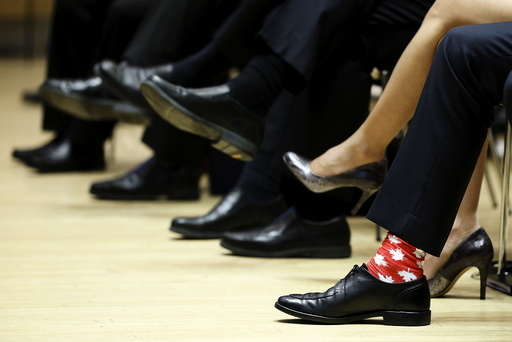 Canada's PM Trudeau wears maple leaf-themed socks during the First Ministers' meeting in Ottawa