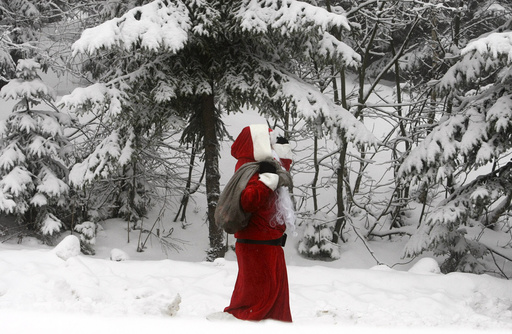 A spectator dressed as Santa Claus walks near the ice track during the men's four-man Bobsleigh World Cup at the German resort of Altenberg