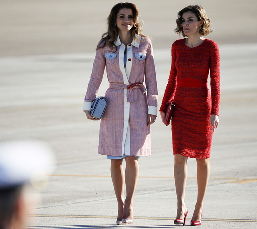 Spain's Queen Letizia walks with Jordan's Queen Rania during a welcoming ceremony at the start of a two-day official visit to Spain in Madrid