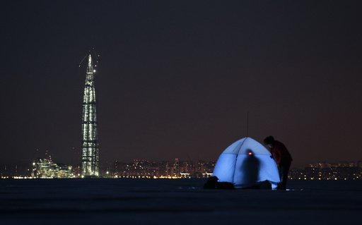 People gather on the ice-covered Gulf of Finland near the business tower Lakhta Centre in St. Petersburg