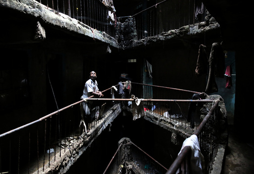 The Wider Image: Tearing down condemned homes in Nairobi