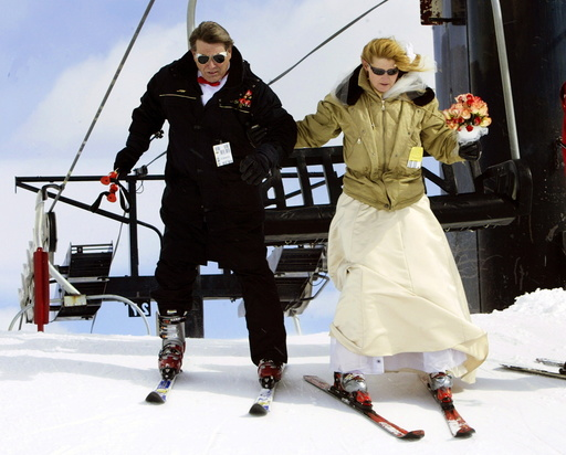 Bride and groom get off ski lift head for mountaintop wedding