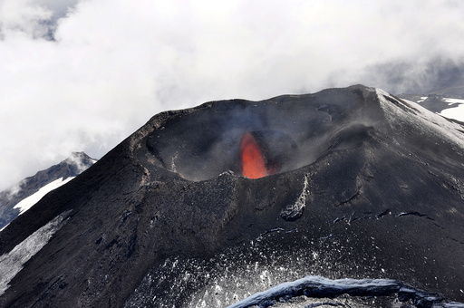 An aerial view shows smoke and lava spewing from the Villarrica volcano south of Santiago