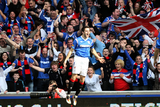 Rangers' Andrew Little celebrates his goal during their Scottish Premier League soccer match against Celtic at Ibrox, Glasgow, Scotland, Sunday, March 25, 2012. (AP Photo/Scott Heppell)