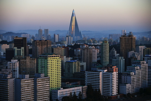 The 105-storey Ryugyong Hotel, the highest building under construction in North Korea, is seen behind residential buildings in Pyongyang