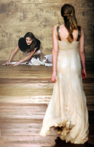 A model falls as she wears a creation by Amanda Wakeley at her show during London Fashion Week