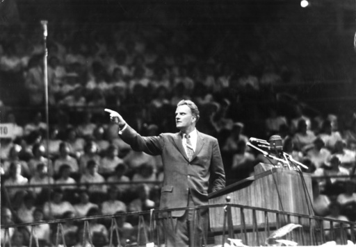 The Rev. Billy Graham speaks at Madison Square Garden in New York on May 15, 1957.