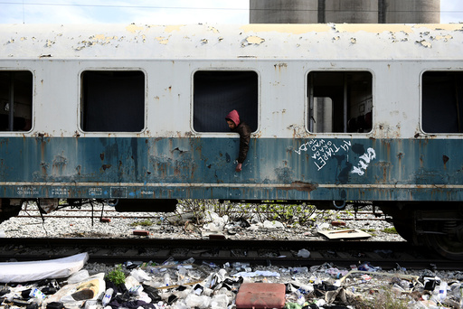 The Wider Image: Migrants ride railroads to seek better future