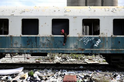 The Wider Image: Migrants ride railroads to seek better future