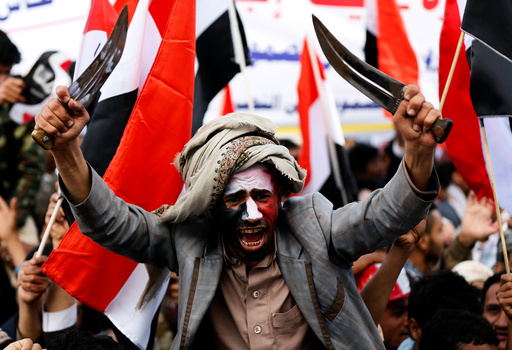 Man waves traditional daggers, or Jambiyas, as he attends with supporters of the Houthi movement and Yemen's former president Ali Abdullah Saleh a rally to mark two years of the military intervention by the Saudi-led coalition, in Sanaa, Yemen