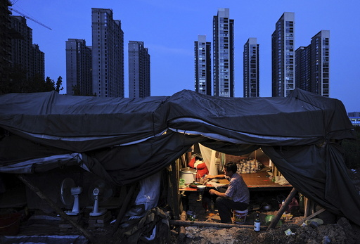 File photo of a labourer having his dinner under his shed at a construction site of a residential complex in Hefei