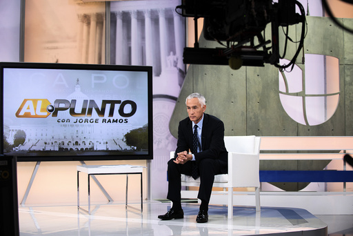 Jorge Ramos, star anchor of the Spanish-language network Univision, reports the news on Univision's