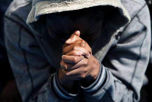 A migrant prays on the Migrant Offshore Aid Station ship Topaz Responder after being rescued around 20 nautical miles off the coast of Libya