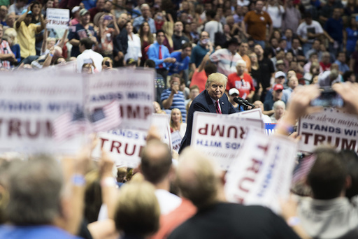 Donald Trump, a Republican presidential hopeful, speaks during a rally at the American Airlines Center in Dallas.