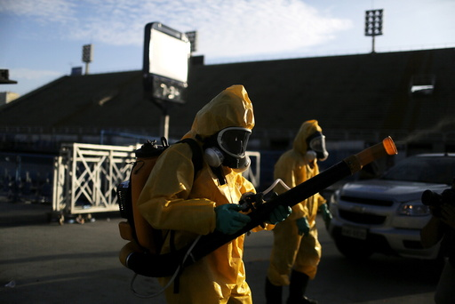 Municipal workers spray insecticide at Sambodrome in Rio de Janeiro