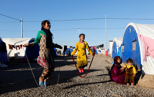 Displaced Iraqi girls who fled the Islamic State stronghold of Mosul, play at Khazer camp