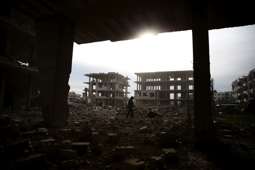 A man walks on the rubble of damaged buildings in the rebel-controlled area of Jobar, a suburb of Damascus
