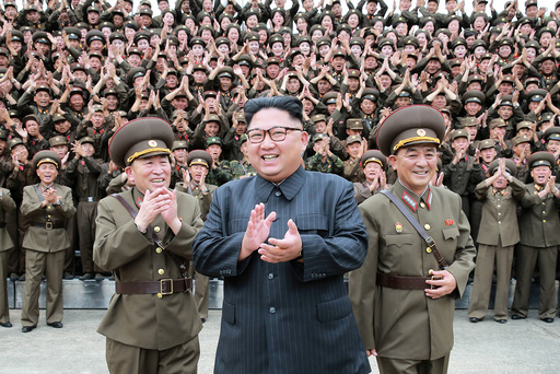 North Korean leader Kim Jong Un claps with military officers at the Command of the Strategic Force of the Korean People's Army (KPA) in an unknown location in North Korea
