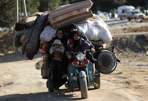 People who fled the violence from Islamic State-controlled northern Syrian town of al-Bab arrive in the rebel-held outskirts of the town