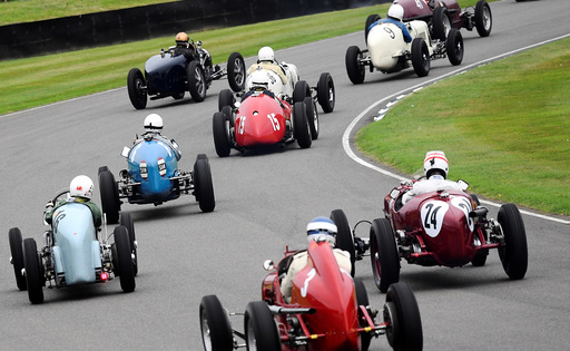 Cars race at the annual Goodwood Revival historic motor racing festival, celebrating a mid-twentieth century heyday of the racing circuit, near Chichester in south England