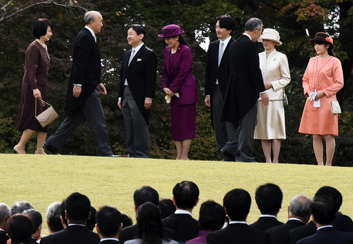 Japan's Crown Prince Naruhito and Crown Princess Masako greet guests with Prince Akishino, Princess Kiko and their daughter Princess Mako, during the annual autumn garden party hosted by Emperor Akihito and Empress Michiko in Tokyo