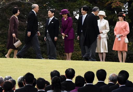 Japan's Crown Prince Naruhito and Crown Princess Masako greet guests with Prince Akishino, Princess Kiko and their daughter Princess Mako, during the annual autumn garden party hosted by Emperor Akihito and Empress Michiko in Tokyo