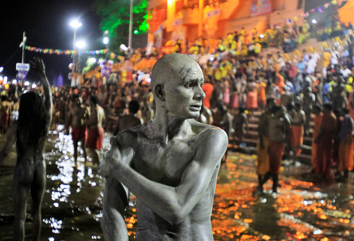 A Sadhu or a Hindu holy man applies ashes on his body after taking a dip in the waters of Shipra river at the Simhastha Kumbh Mela in Ujjain