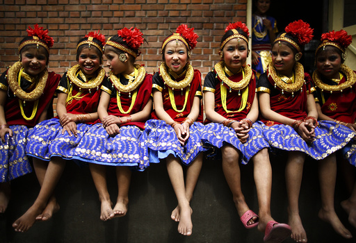 Girls take part in a function organised to mark International Women's Day at Maiti Nepal in Kathmandu