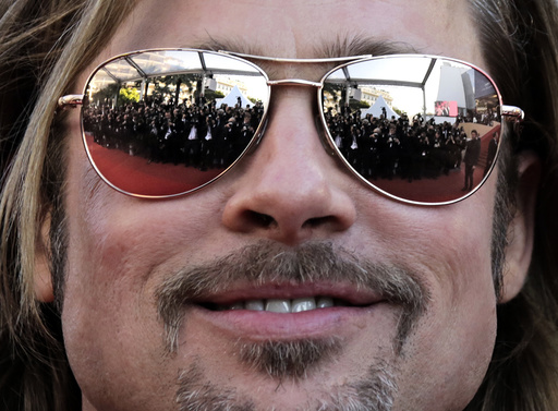 Cast member Pitt poses on the red carpet ahead of the screening of the film Killing Them Softly in competition at the 65th Cannes Film Festival