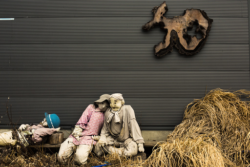 Scarecrows sit in front of a shed in the mountain village of Nagoro
