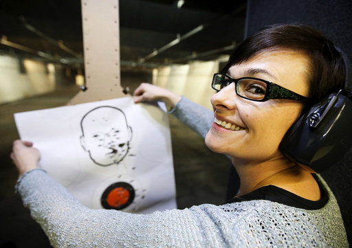 First time gun owner, Jessie Palmieri holds a target she shot with a H&K VP9 9mm gun at the Ringmasters of Utah gun range