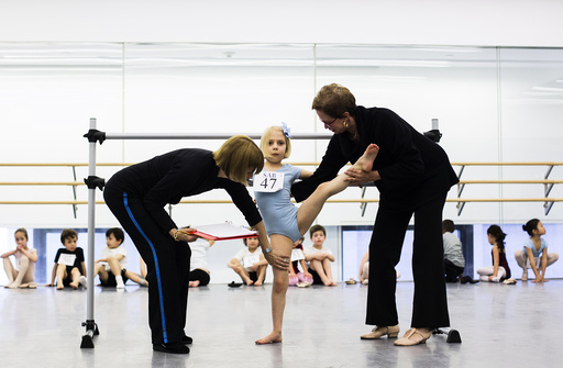 A young ballet dancer is evaluated by staff of the School of American Ballet during auditions in New York