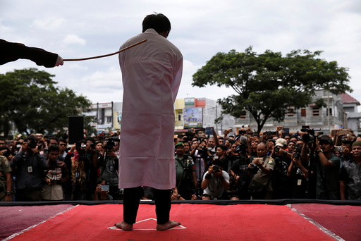 An Indonesian man is publicly caned for having gay sex, in Banda Aceh