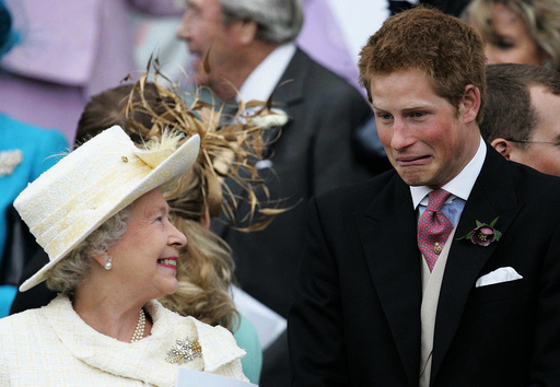Britain's Queen Elizaberth II smiles as Prince Harry pulls a face as they watch Prince Charles and the ...