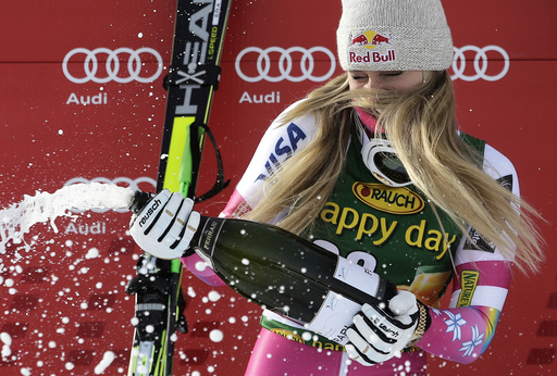 Lindsey Vonn of the U.S. sprays champagne on the podium after winning the women's World Cup Super-G skiing race in Cortina D'Ampezzo
