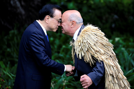 Chinese Premier Li Keqiang hongis, a traditional New Zealand Maori welcome, with Piri Sciascia during an official welcoming ceremony at Government House in Wellington, New Zealand