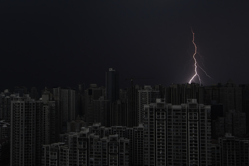 Lightning is seen above buildings during a storm in central Shanghai