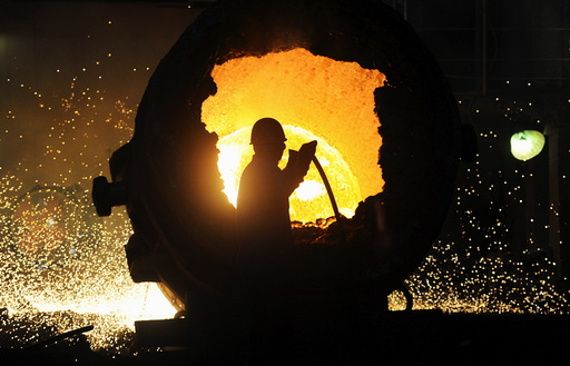 File photo of a worker operating a furnace at a steel plant in Hefei