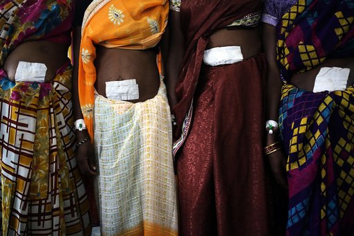 Women, who underwent sterilization surgery at a government mass sterilisation camp, pose for pictures at Bilaspur district in Chhattisgarh