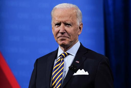President Joe Biden deltar på to digitale toppmøter samme dag som USA vender tilbake til Parisavtalen. Foto: Evan Vucci / AP / NTB